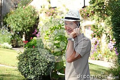 Senior gentleman making a call