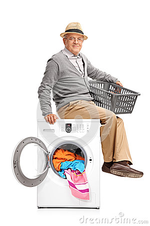 sitting on a washing machine