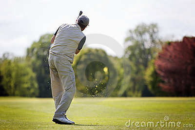 Senior golfer on fairway.