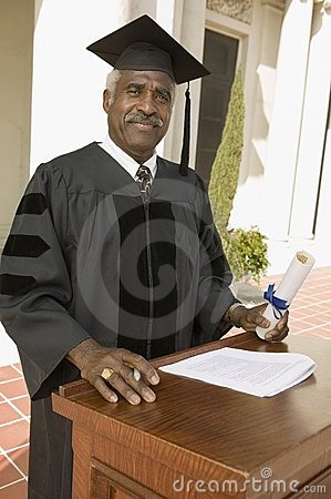 Senior graduate at podium outside