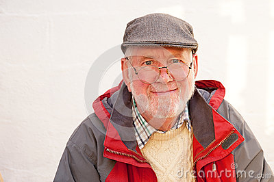 Senior in gray flat cap