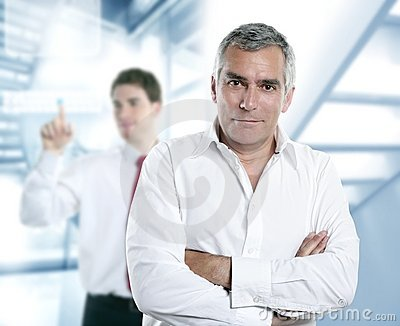 Senior gray hair manager in hi-tech office