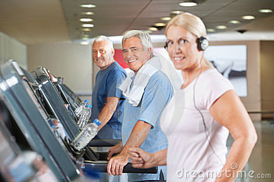 Senior group on treadmills in gym