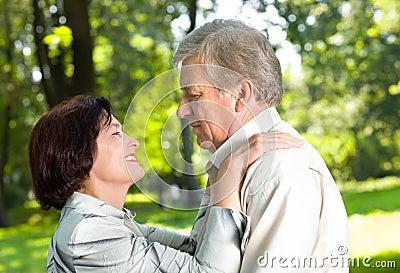Senior happy couple walking