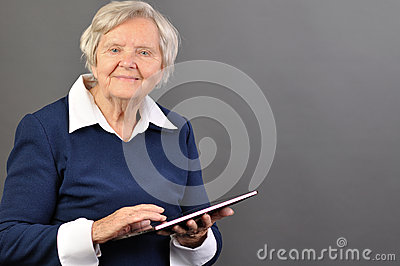 Senior happy woman with tablet.