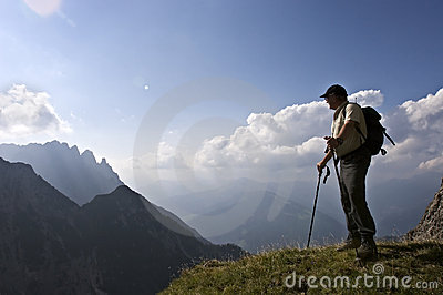 Senior hiker enjoying amazing landscape of the Alp