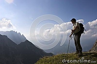 Senior hiker enjoying amazing landscape of the Alp