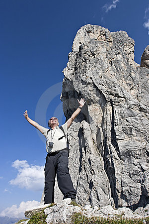 Senior hiker enjoying at summit
