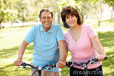 Senior Hispanic couple on bikes