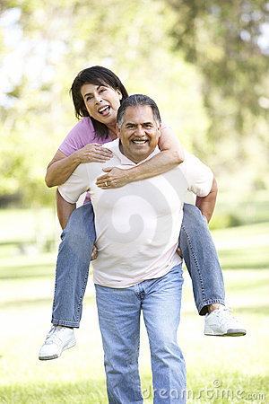 Senior Hispanic Couple Having Fun In Park