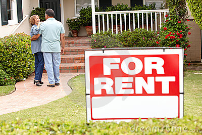 Senior Hispanic couple renting new home