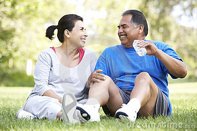 Senior Hispanic Couple Resting After Exercise