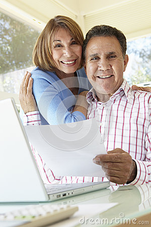 Free Senior Hispanic Couple Working In Home Office Royalty Free Stock Image - 54948266