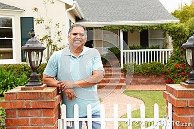 Senior Hispanic man outside home