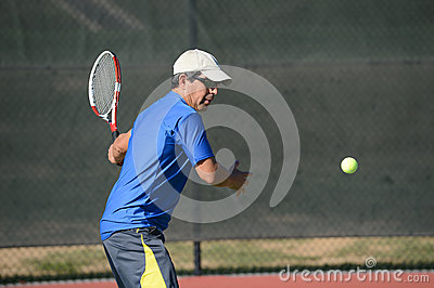 Senior Hispanic Playing Tennis