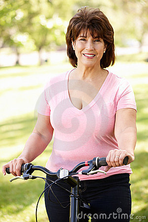 Senior Hispanic woman with bike