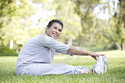 Senior Hispanic Woman Exercising In Park
