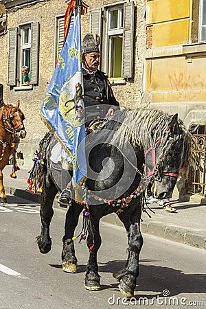 Senior horseman holding flag Editorial Stock Image