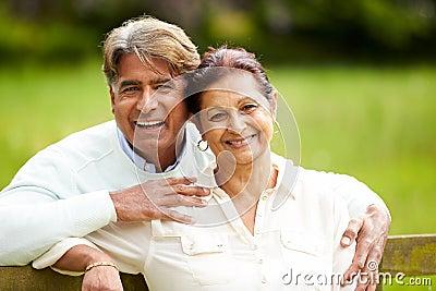 Senior Indian Couple Walking In Countryside