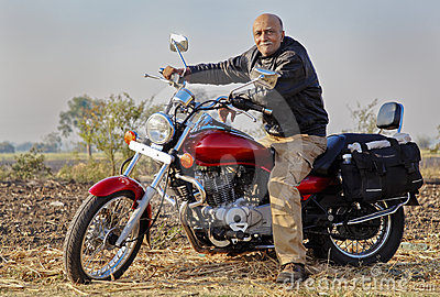 Senior Indian Motor bike rider on a cruiser