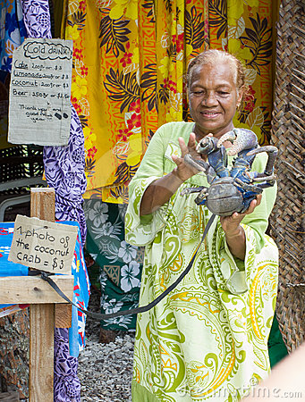 Senior indigenous lady holding a Coconut Crab Editorial Stock Image