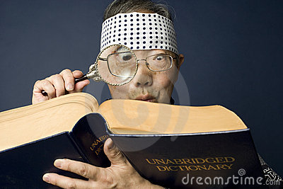 Senior japanese man examines dictionary
