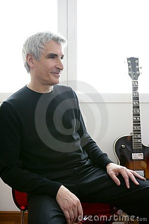 Senior jazz musician portrait, guitar