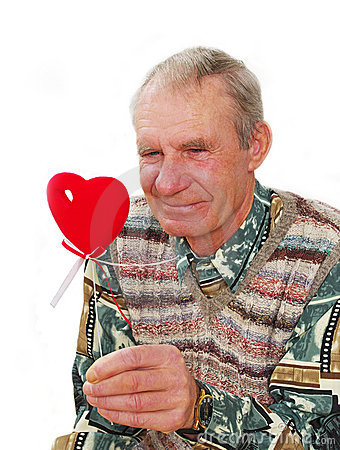 Senior keeping fake heart.