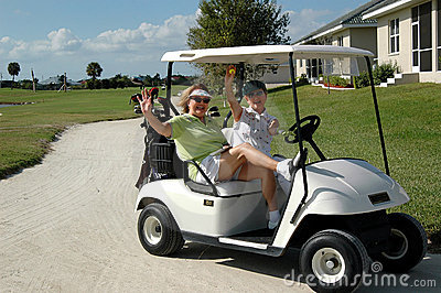 Senior ladies in golf cart