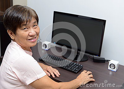 Senior lady with desktop computer