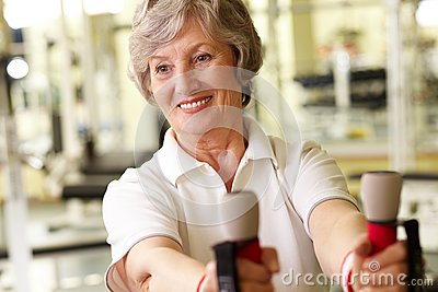 Senior lady at gym
