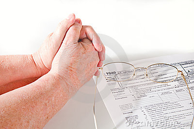 Senior Lady hands with income tax forms