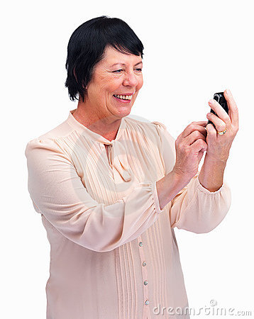 Senior lady happy to receive a text message