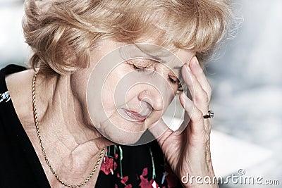 Senior lady with headache