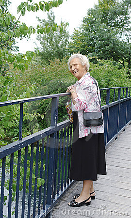 Free Senior Lady On Bridge Stock Images - 1174224