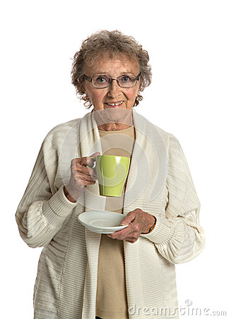 Senior Lady Smiling Holding a Cup of Coffee