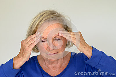 Senior Lady Suffering With A Headache Stock Photo - Image ...