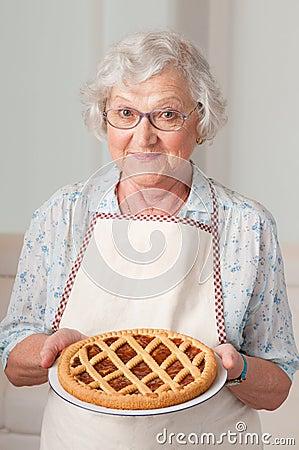 Free Senior Lady With Homemade Cake Stock Photography - 21389912