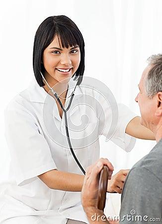Senior laughing with his nurse