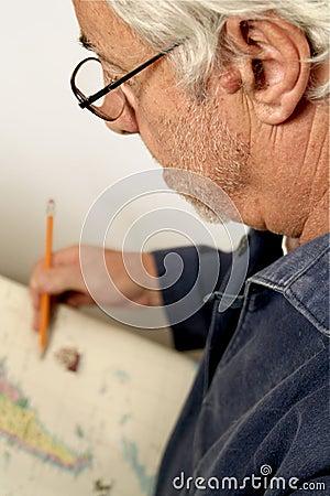 Senior looking at map