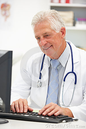 Senior male doctor at desk