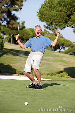Senior Male Golfer On Golf Course