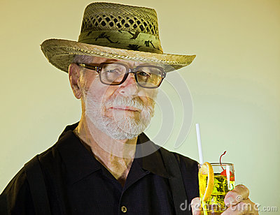 Senior Male Holding A Cocktail
