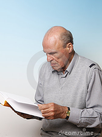 Senior male reading