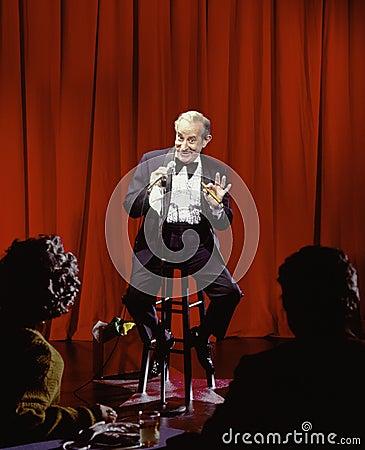 Senior male standup comedian
