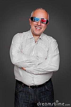 Senior man in 3d glasses standing