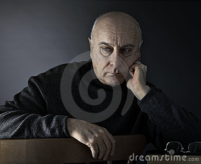 Senior man absorbed in thought