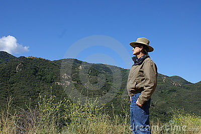 Senior Man Alone Looking at Mountains