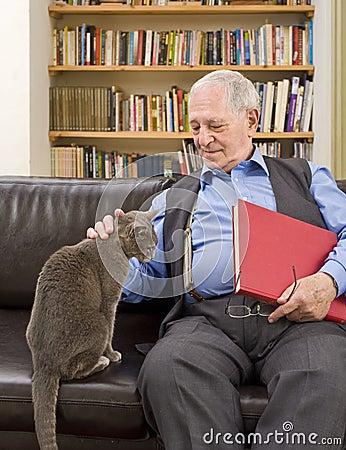 Free Senior Man And Cat Stock Photos - 12718073