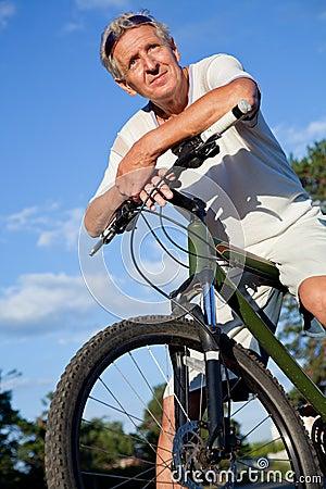 Senior man with bicycle